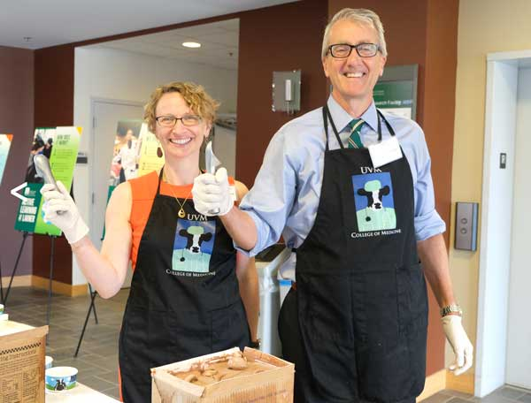 Drs Page and Zehle posing with ice cream scoops at the annual ice cream social